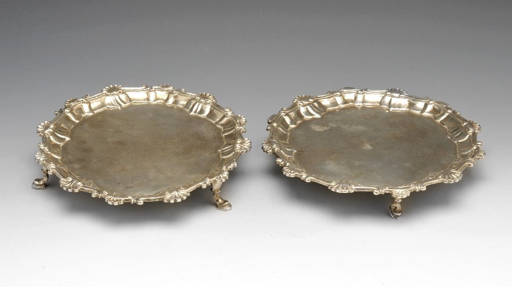 A George III matched pair of silver waiters.