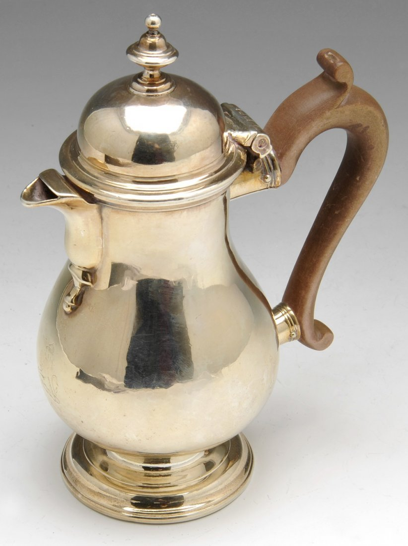 A George II silver hot milk pot.