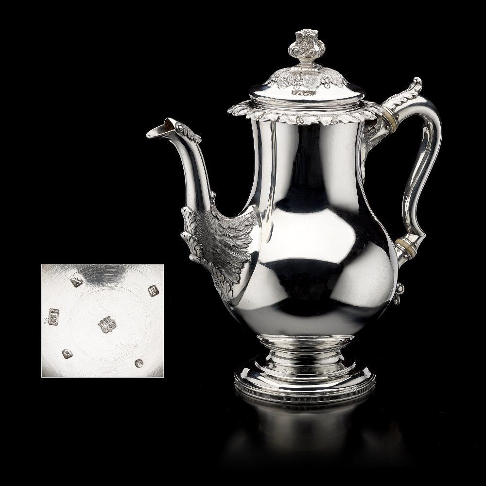 A George IV silver Scottish coffee pot.