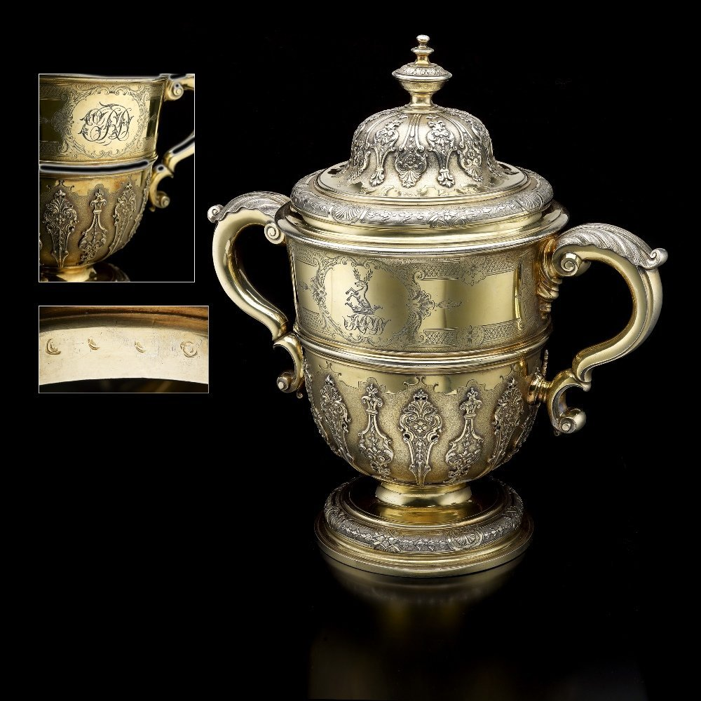 A George II silver-gilt cup and cover.