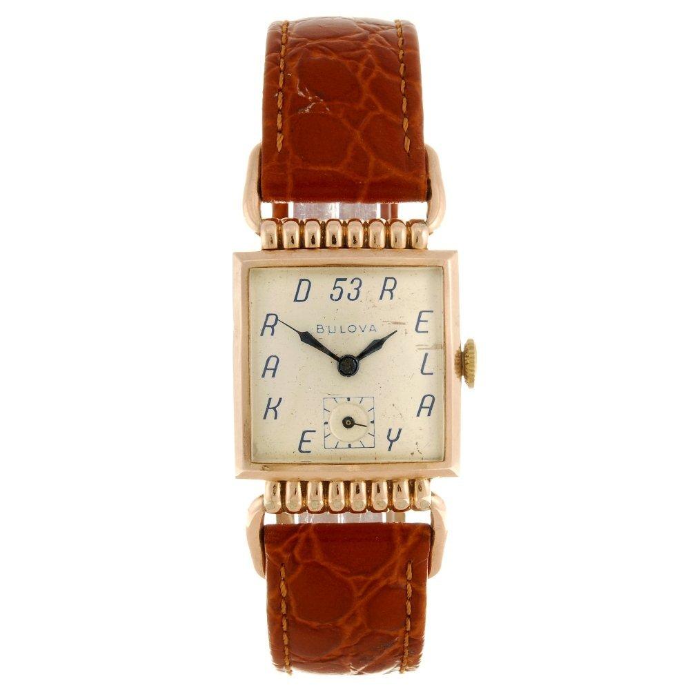 A bi-colour manual wind Bulova wrist watch.