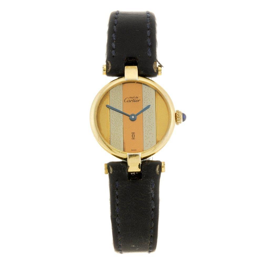 A gold plated silver quartz Must de Cartier wrist