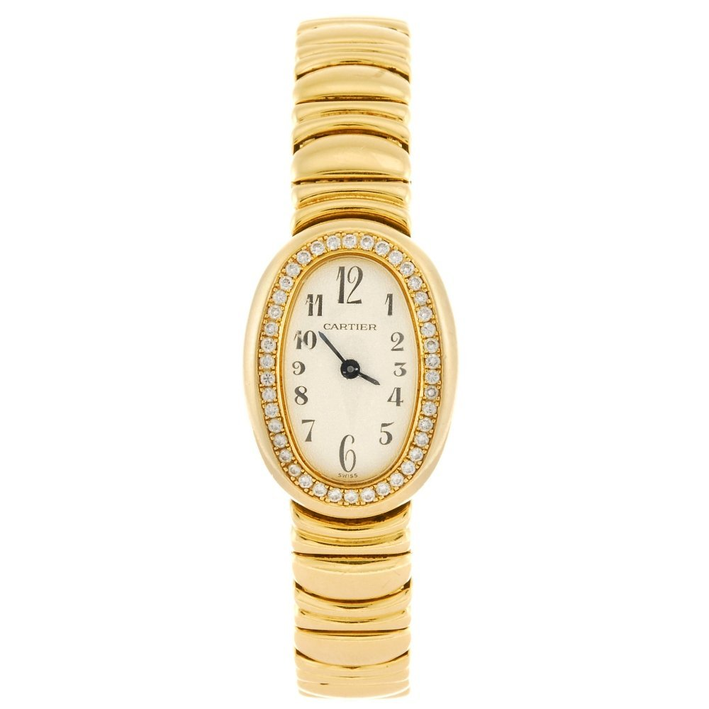 (973015856)  An 18k gold quartz lady's Cartier Mini