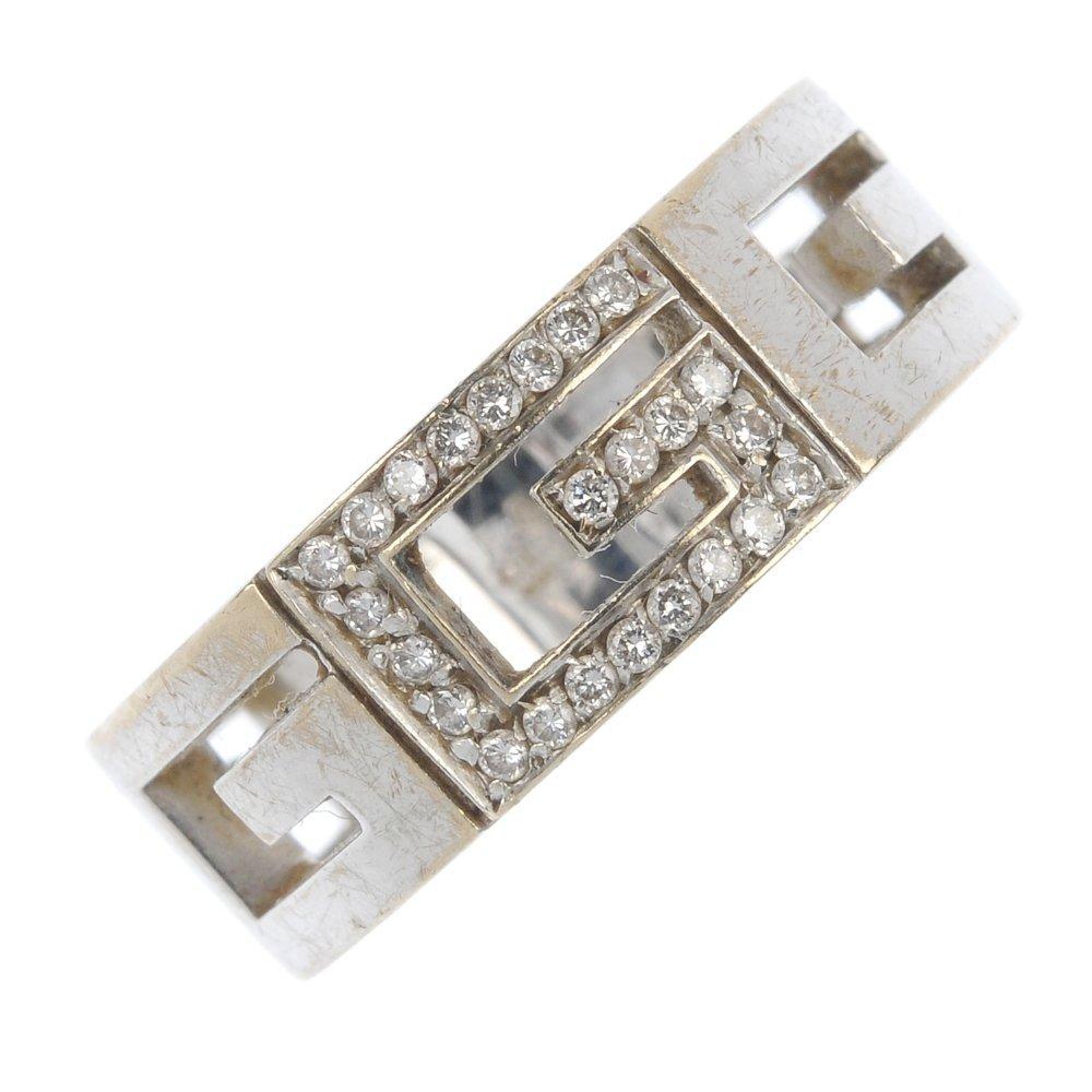 GUCCI - a diamond 'G' ring.
