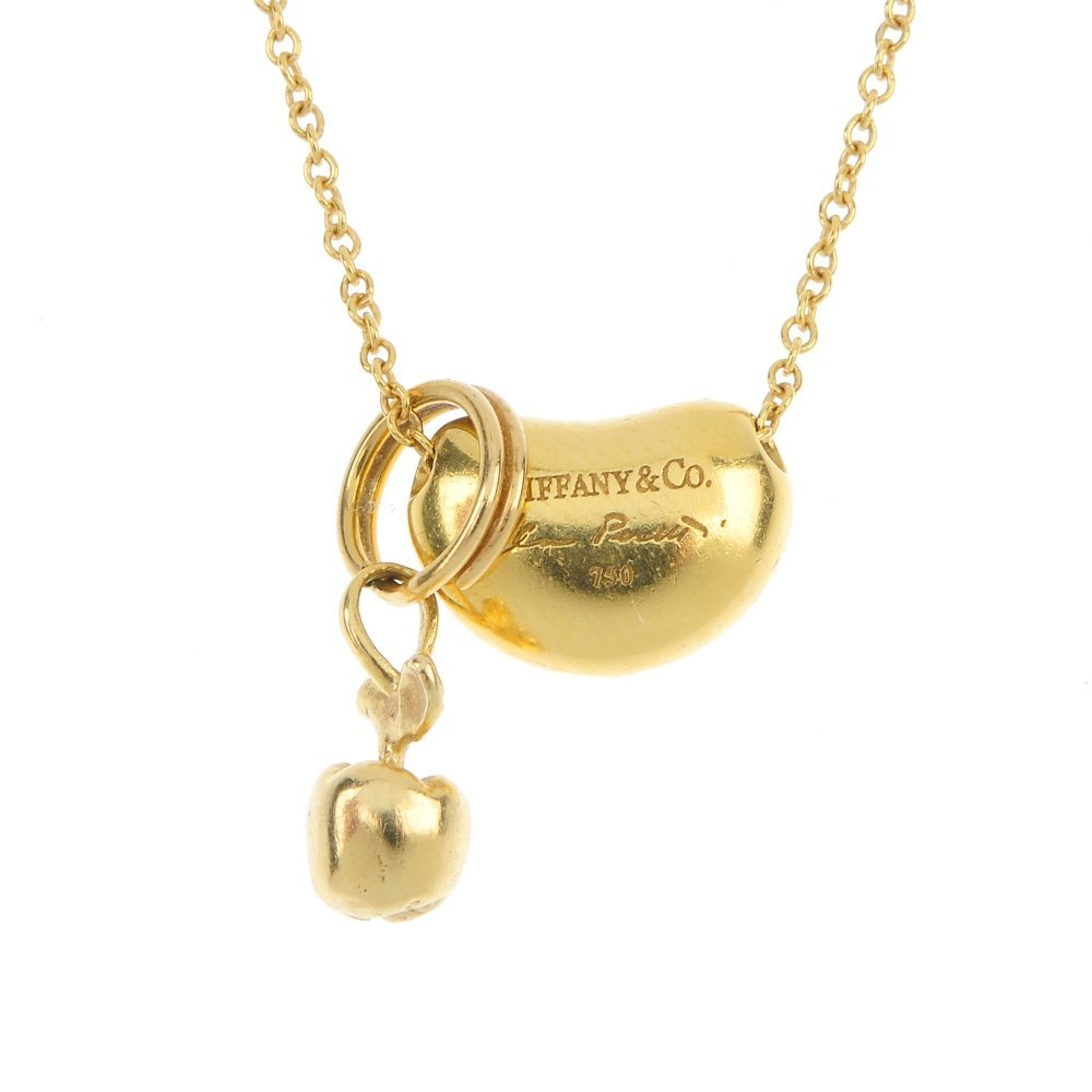 TIFFANY & CO. - a bean pendant, by Elsa Peretti and an