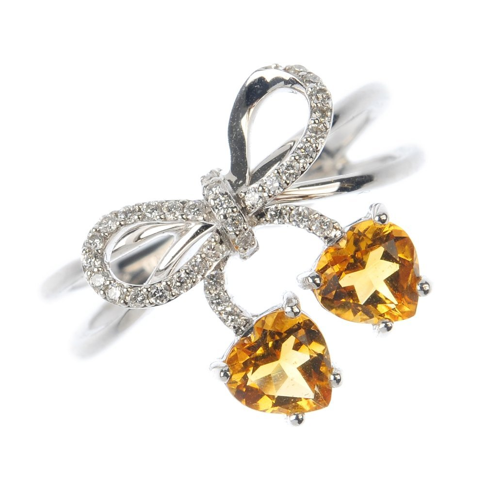 An 18ct gold diamond and citrine dress ring.