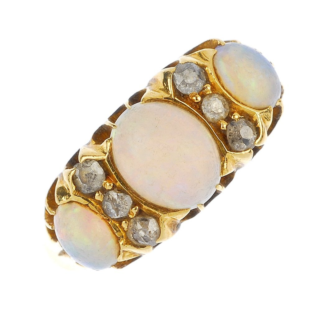 An early 20th century gold opal and diamond ring.