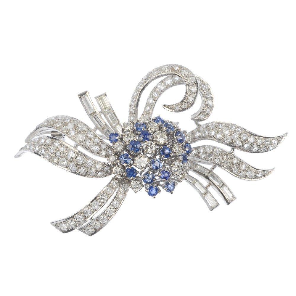 A mid 20th century sapphire and diamond floral spray