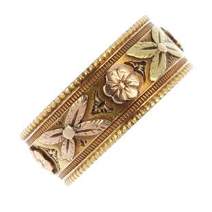A late Victorian 18ct gold floral band ring.