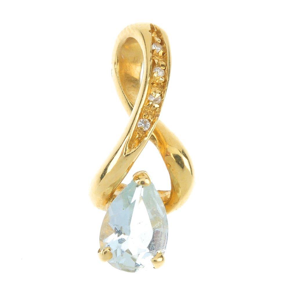 An 18ct gold blue gem and diamond pendant.