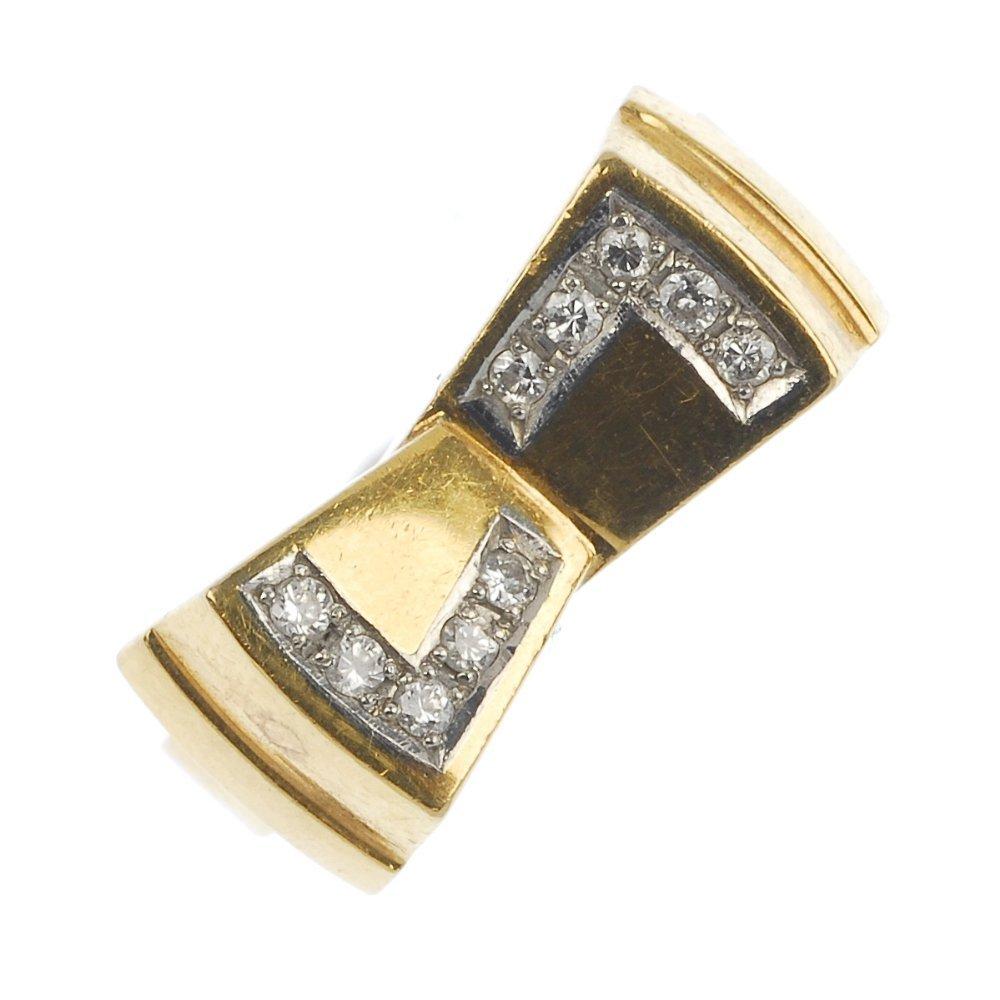 A diamond bow dress ring.