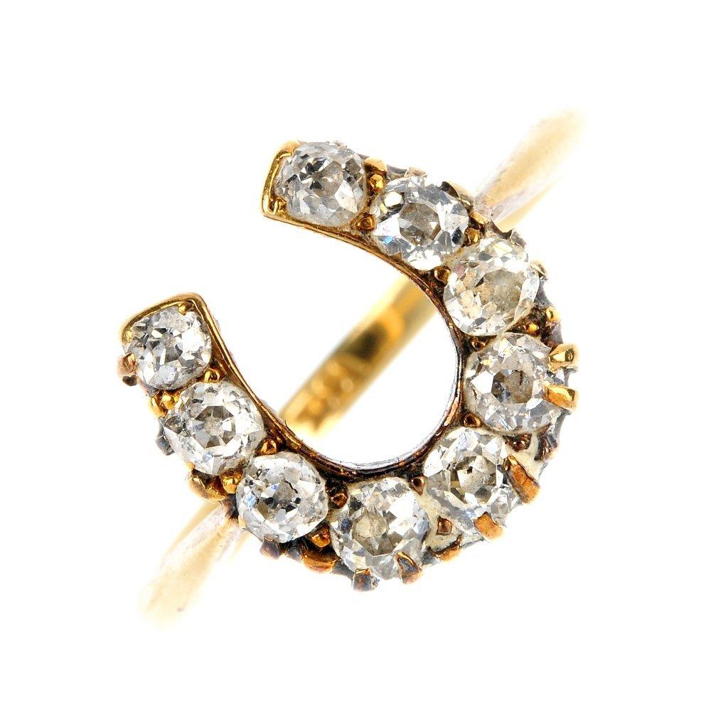 An early 20th century 18ct gold diamond horseshoe ring.