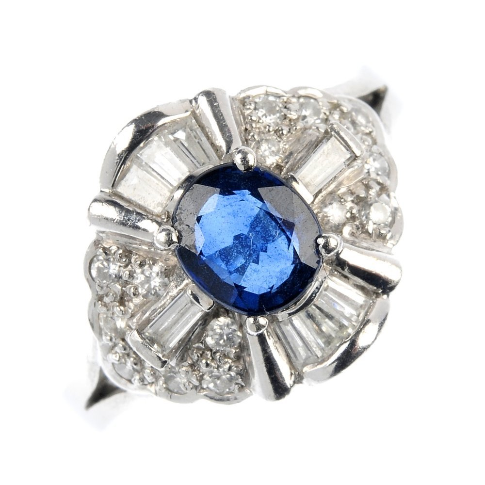 A platinum sapphire and diamond cluster ring.