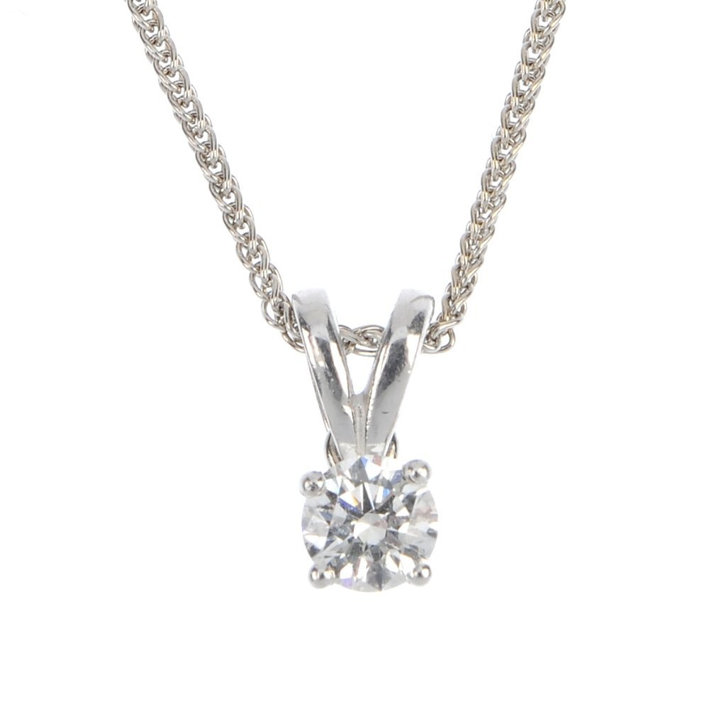 An 18ct gold diamond single-stone pendant.