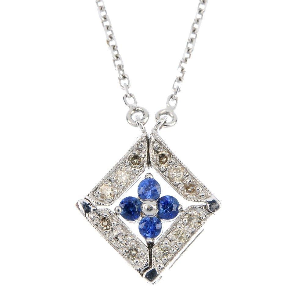 An 18ct gold sapphire and diamond pendant.