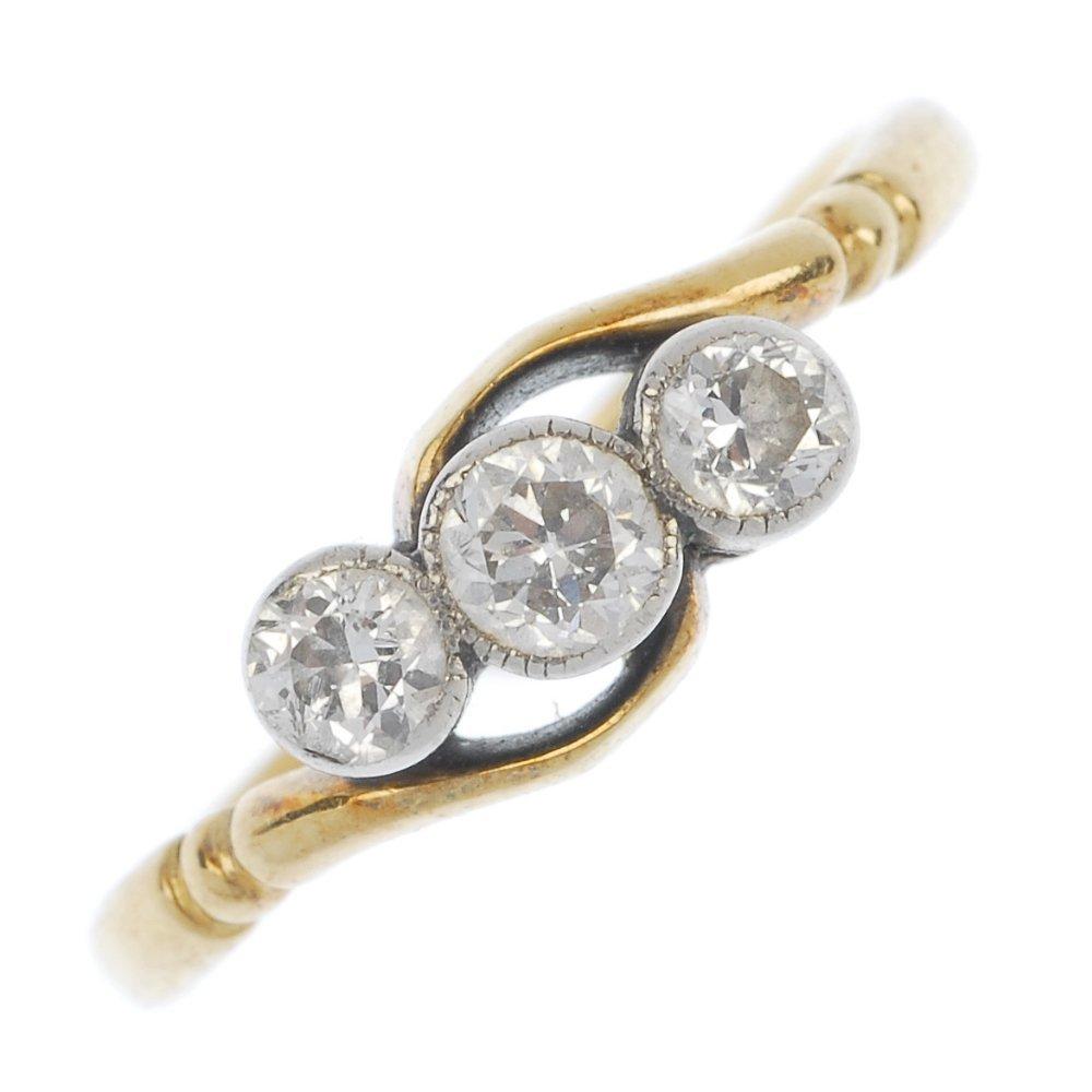 An 18ct gold and platinum diamond three-stone ring.