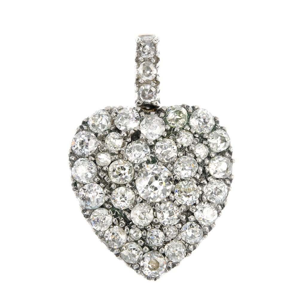 A late 19th century 9ct gold and silver diamond heart
