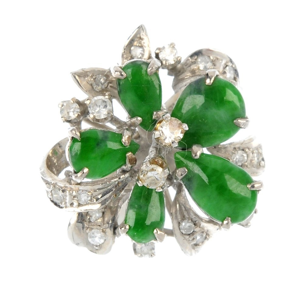 A jade and diamond floral cluster ring.