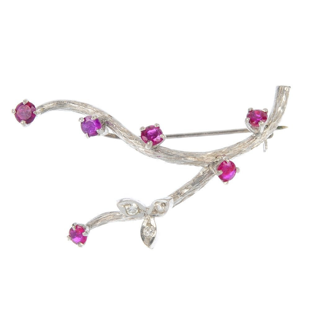 A mid 20th century diamond and ruby foliate brooch.
