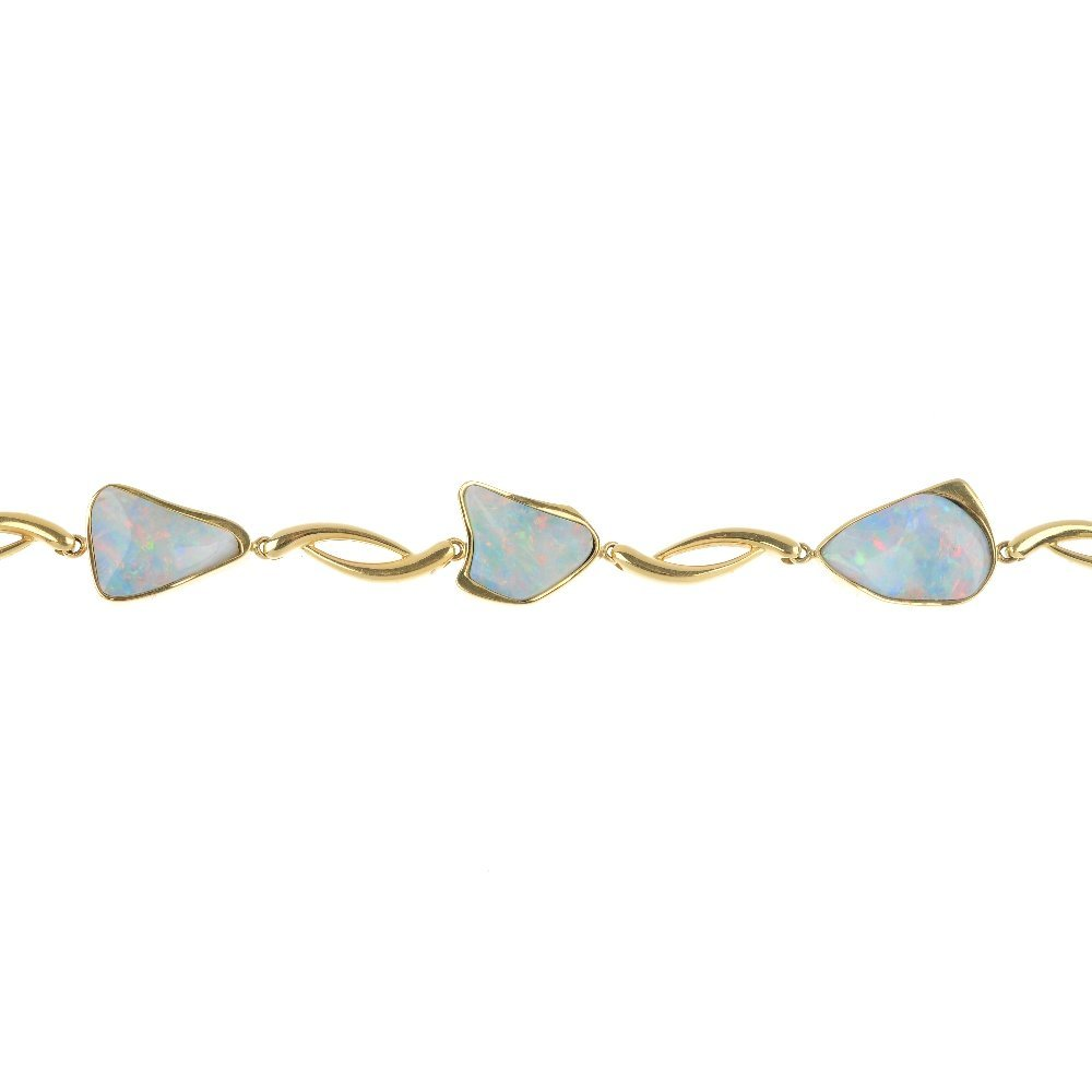 An 18ct gold opal and diamond bracelet.