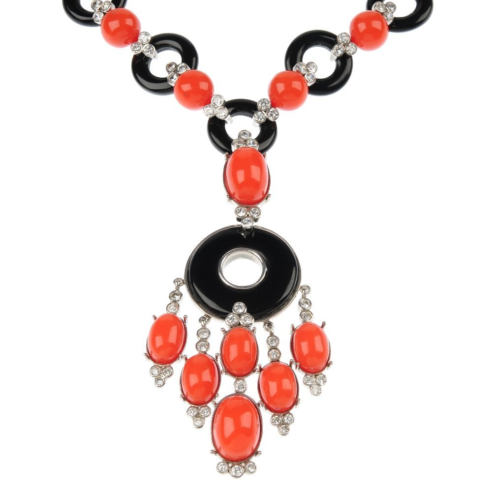 An orange and black paste and plastic necklace