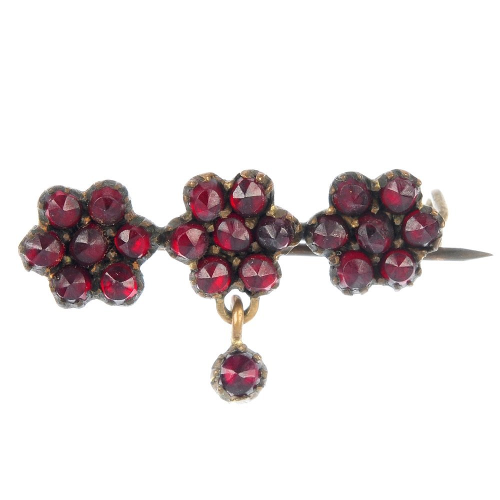 A late 19th century garnet and paste bangle and brooch.