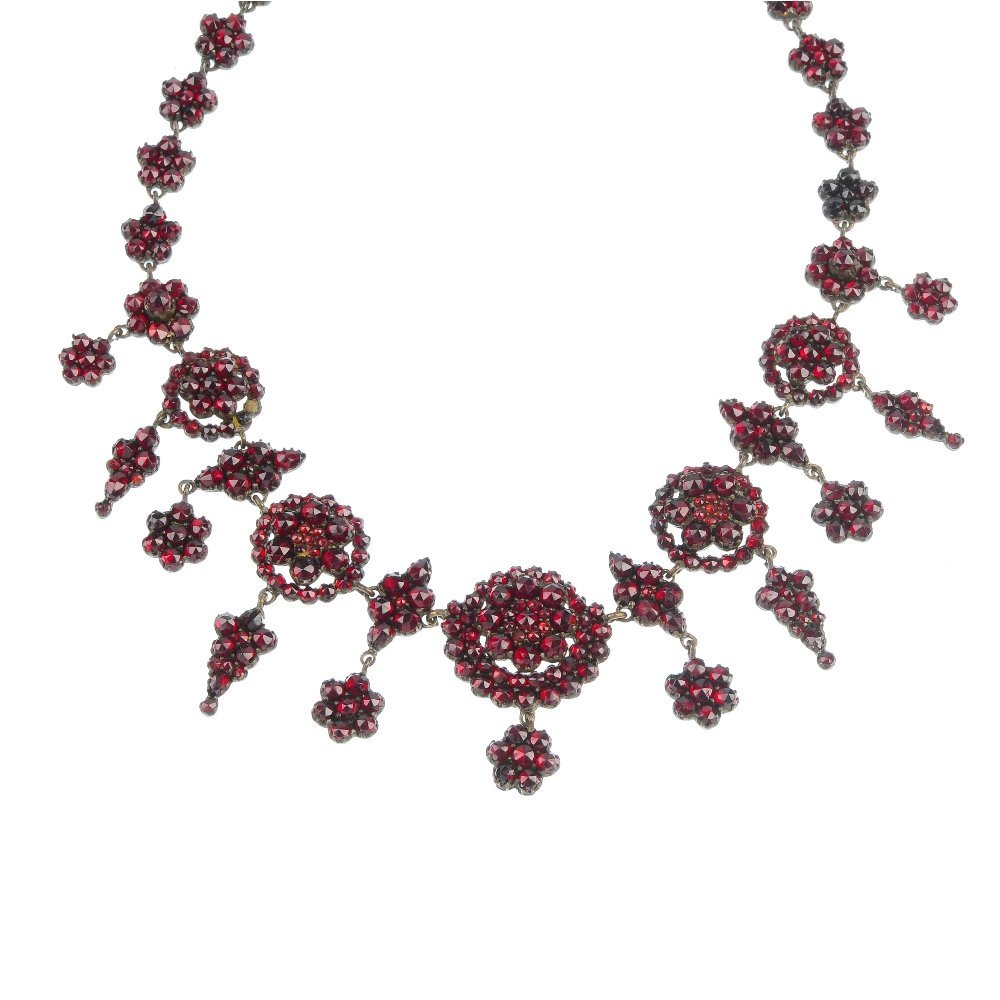 A late 19th century garnet and paste necklace.