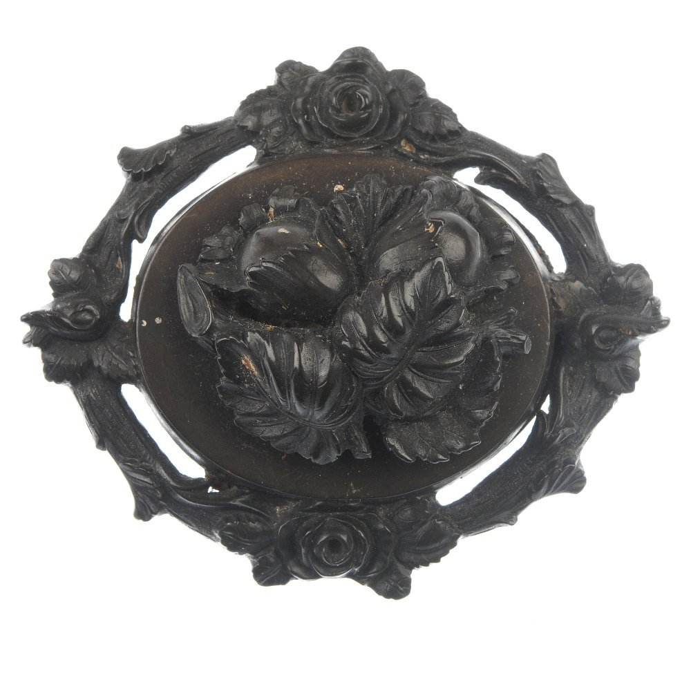 A late Victorian vulcanite brooch and two jet and cameo