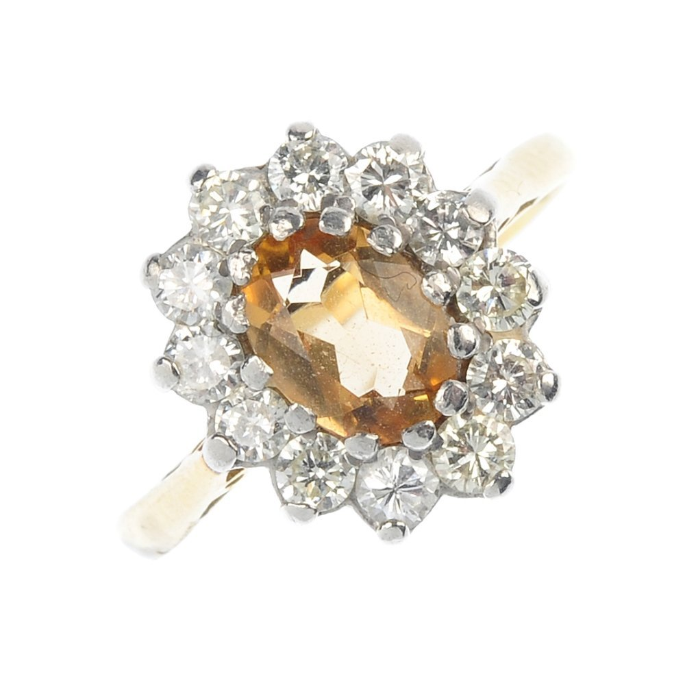 A topaz and diamond cluster ring.