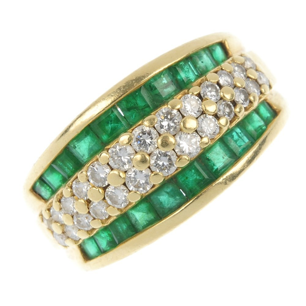 An 18ct gold emerald and diamond band ring.