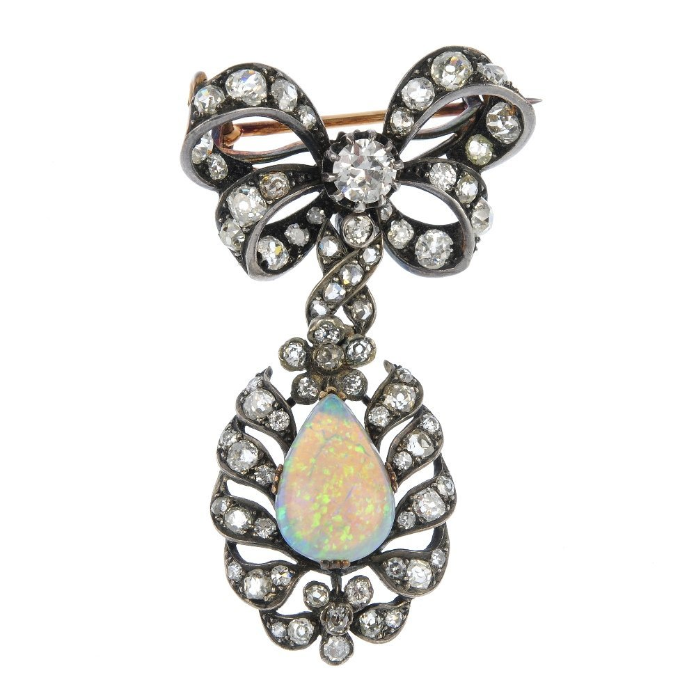 A late 19th century opal and diamond bow brooch.