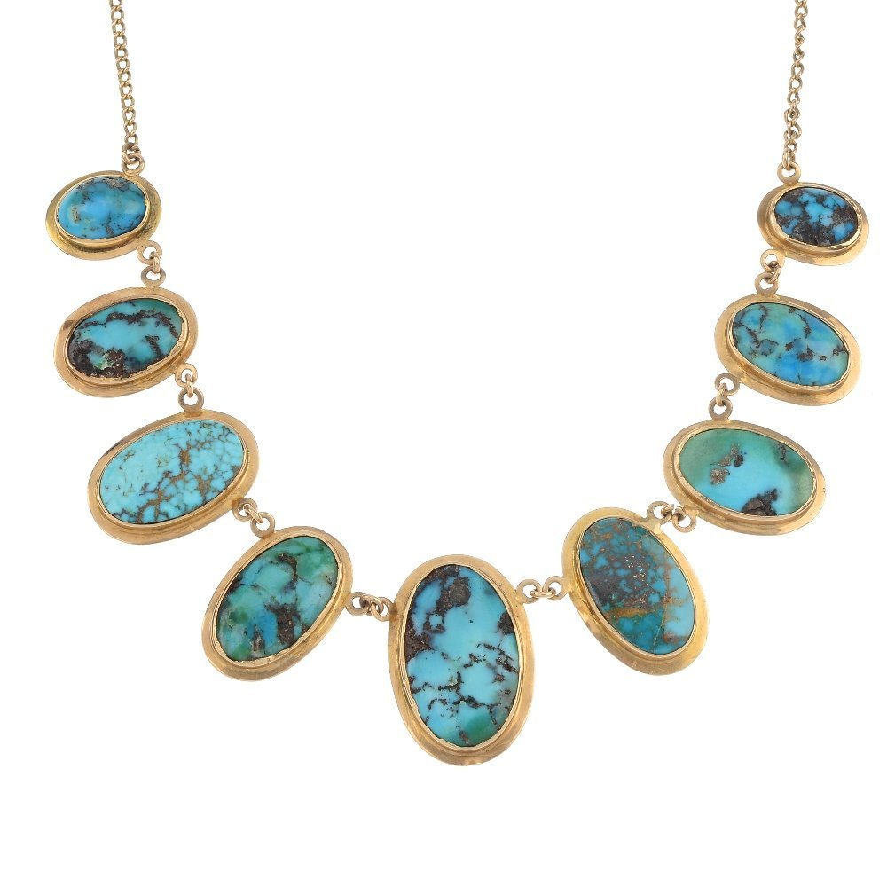A turquoise necklace and earrings set.