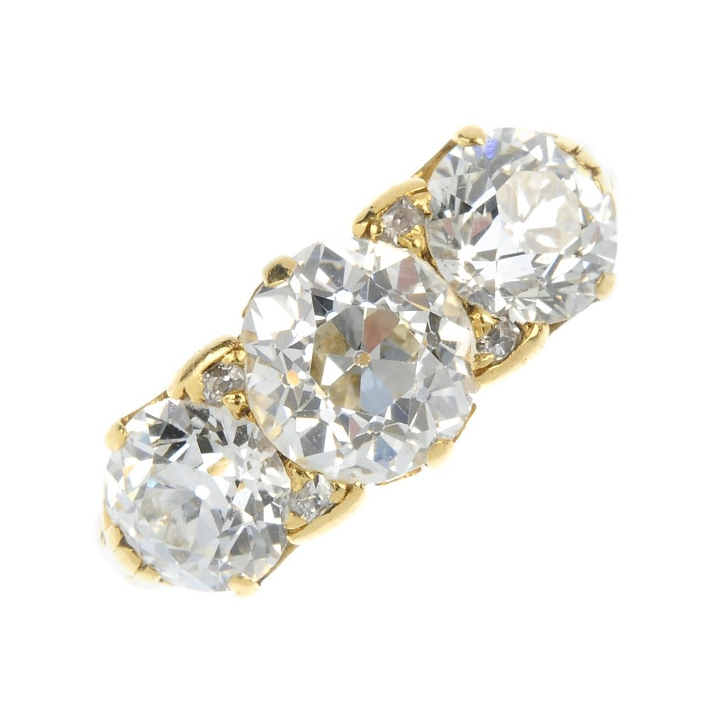 A late 19th century 18ct gold diamond three-stone ring.