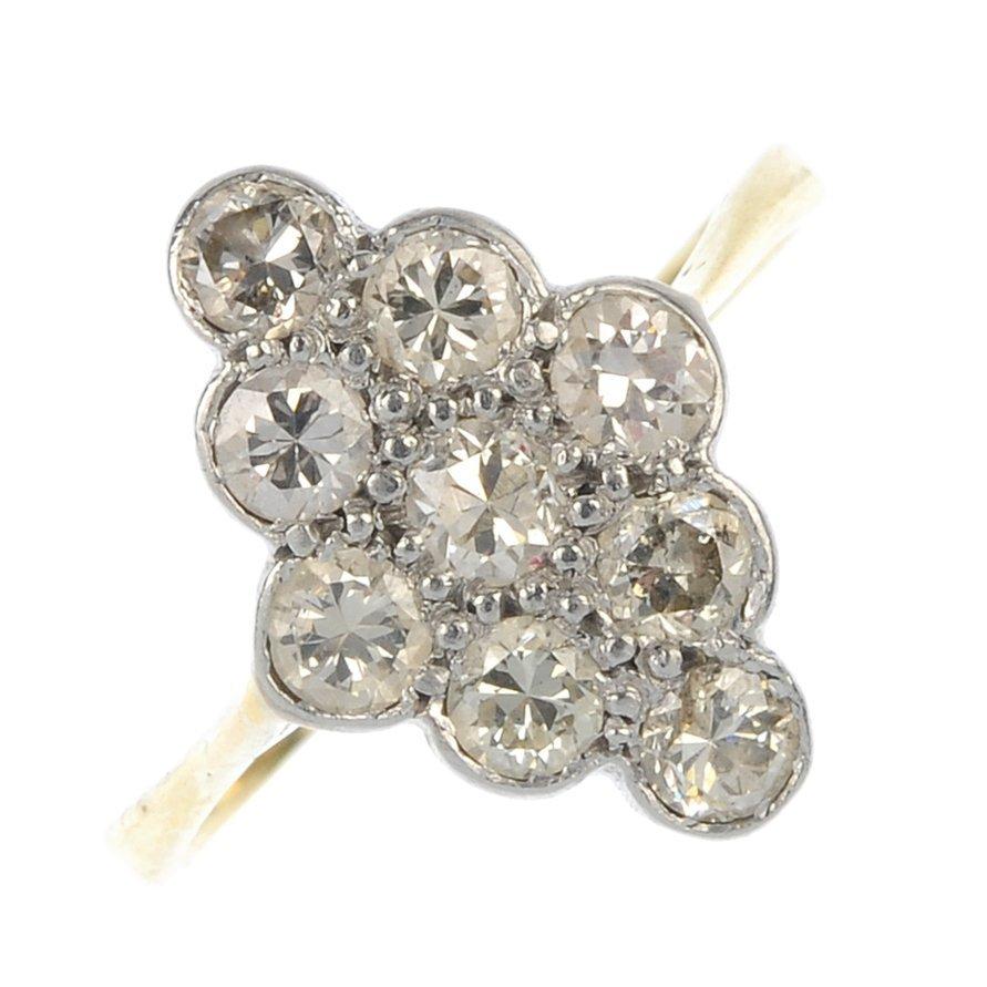 A mid 20th century diamond panel ring.