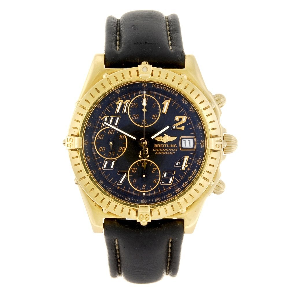 (946001863) An 18k gold automatic chronograph gentleman