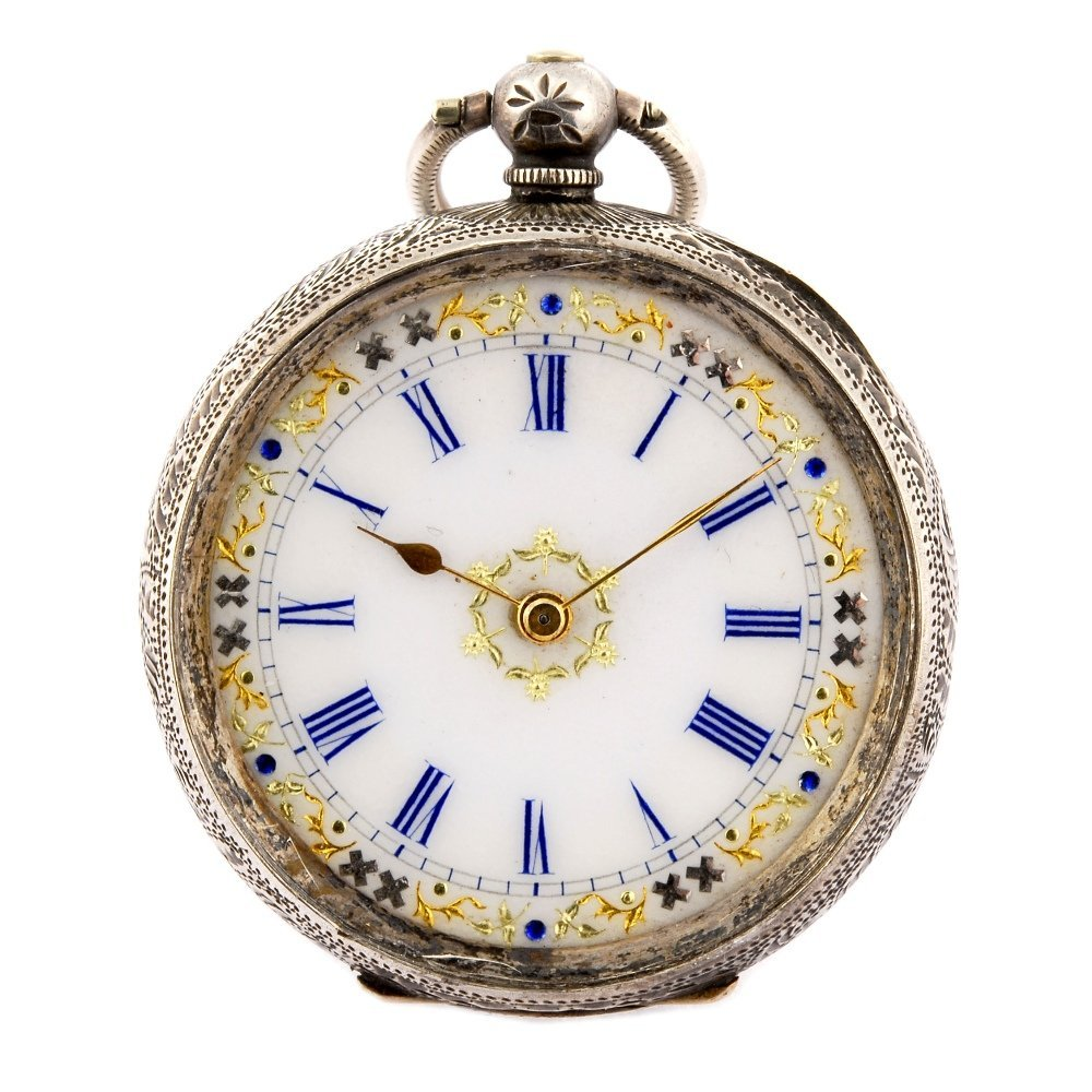 A continental white metal key wind pocket watch with a