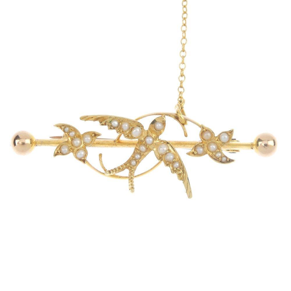 An early 20th century gold split pearl bar brooch.