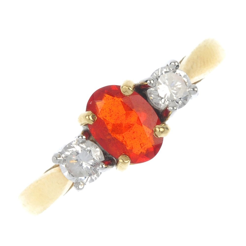 An 18ct gold fire opal and diamond three-stone ring.