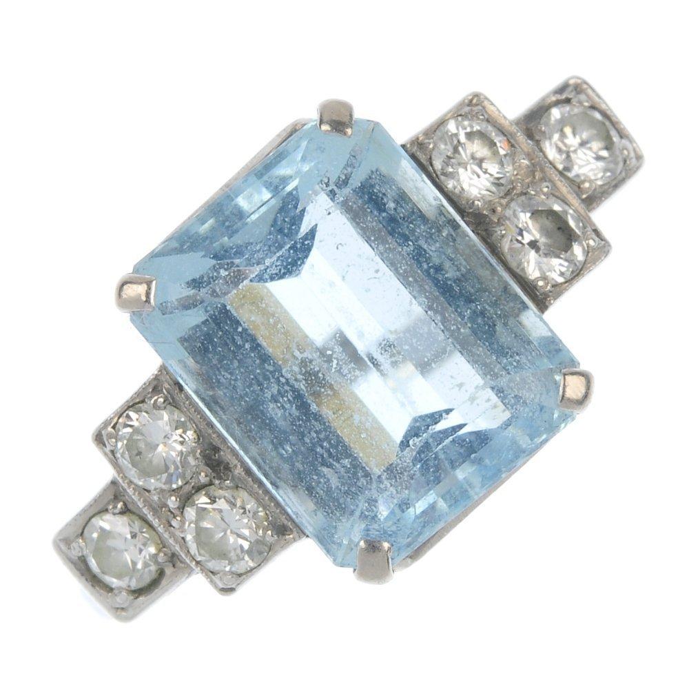 A mid 20th century 18ct gold and platinum aquamarine