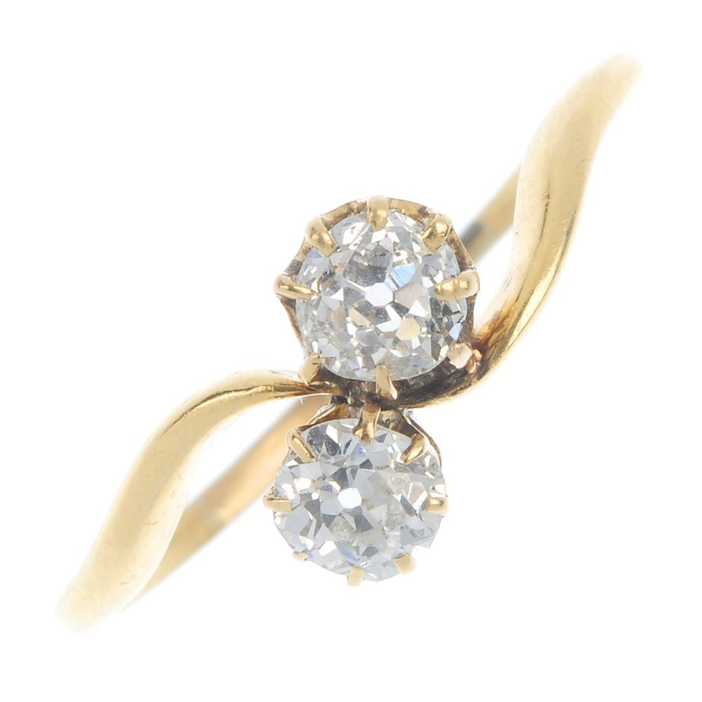 An early 20th century 18ct gold diamond two-stone ring.