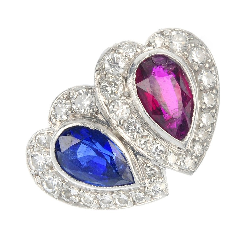 A platinum diamond, sapphire and ruby heart ring.