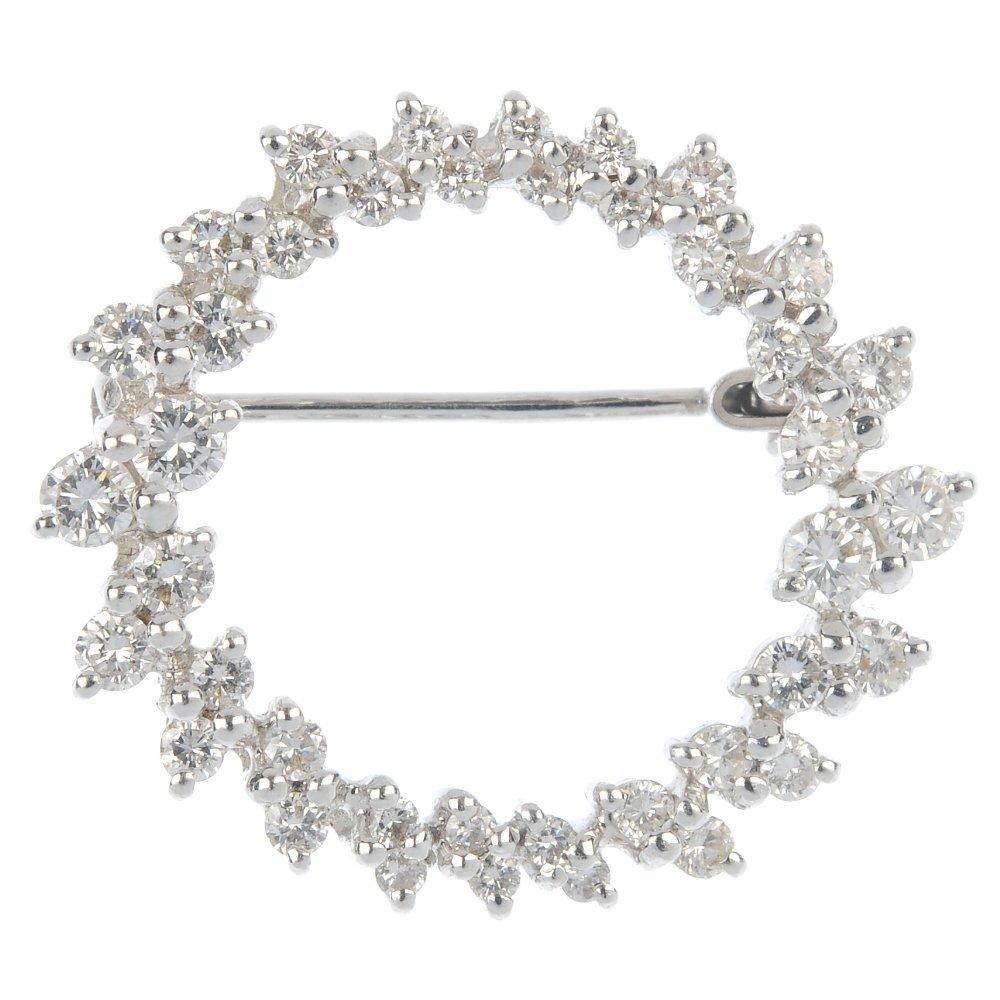 A brilliant-cut diamond brooch.