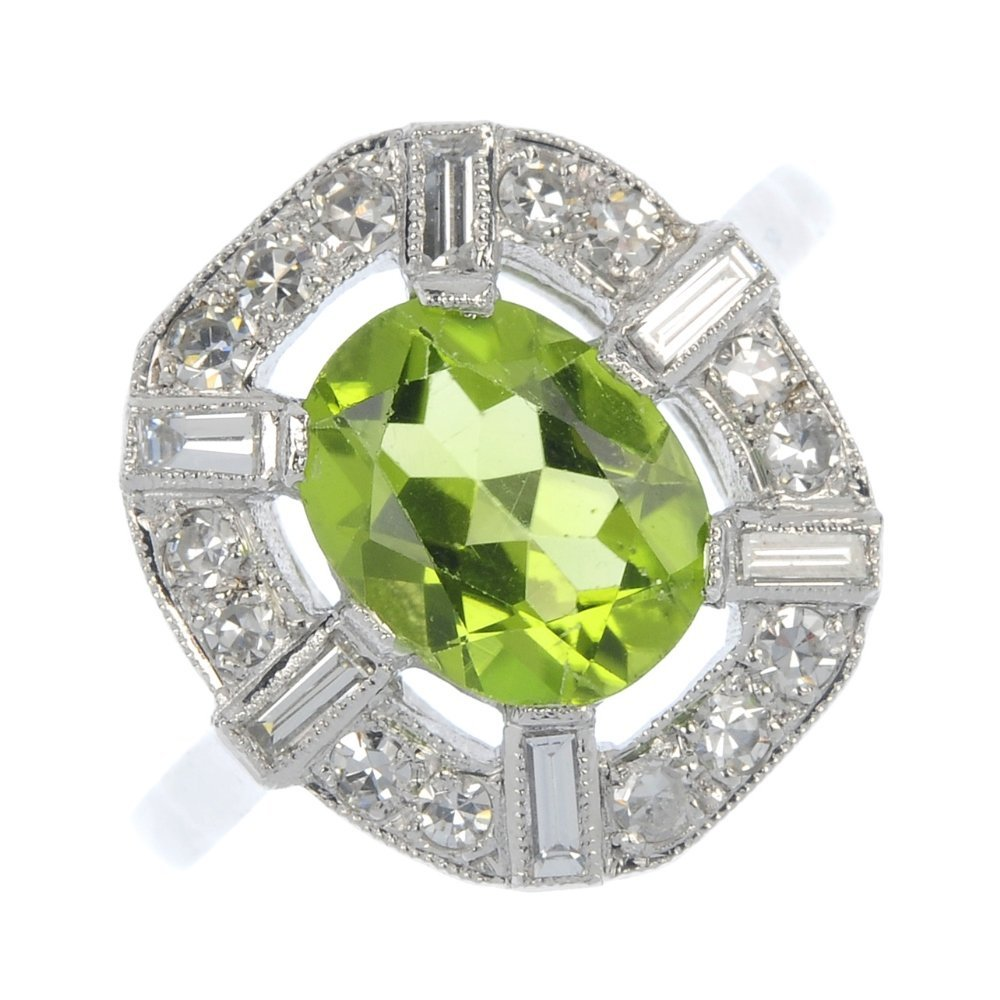 A peridot and diamond cluster ring.