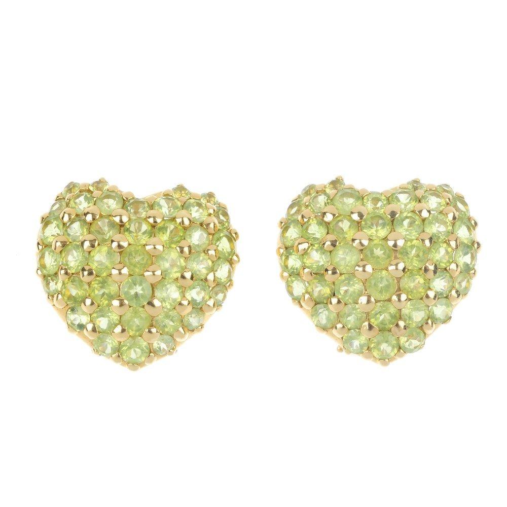 A pair of peridot heart ear clips.