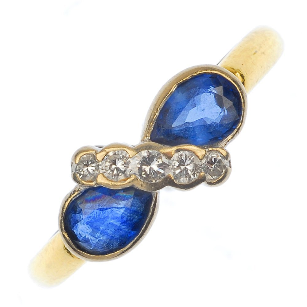An 18ct gold sapphire and diamond dress ring.