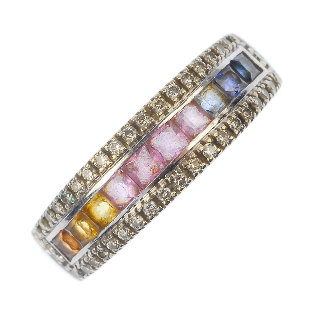 A sapphire and diamond half-circle eternity ring.