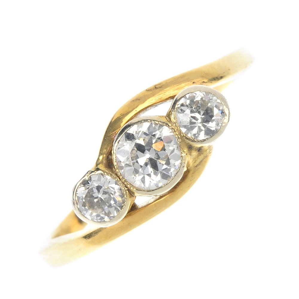 An early 20th century 15ct gold diamond three-stone