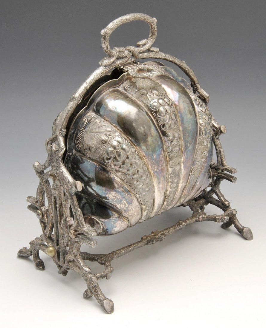 A Victorian silver plated folding biscuiteer.