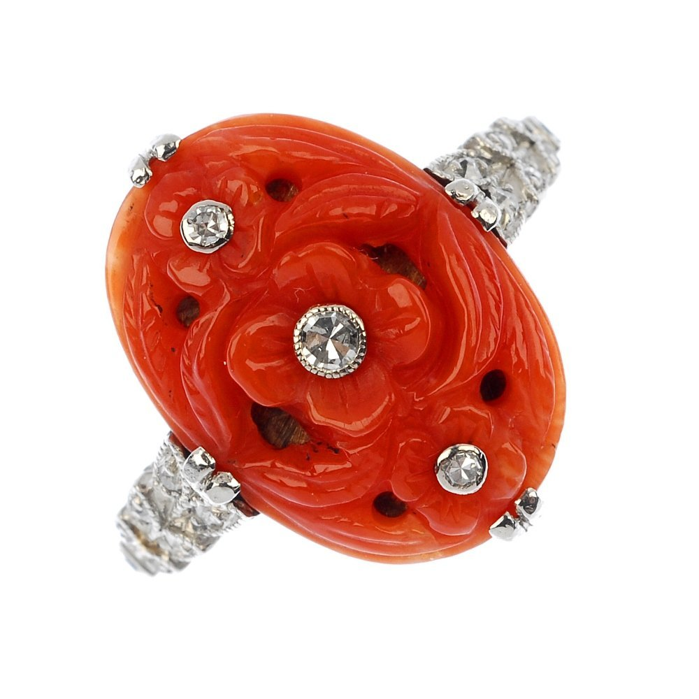 A coral and diamond ring.