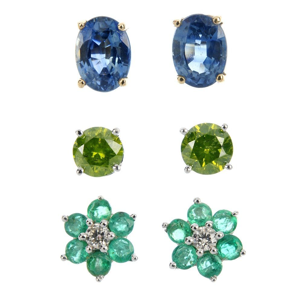 A selection of three pairs of gem-set ear studs.